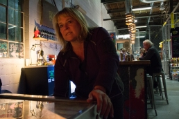 Englewood, Colo. – April 22, 2017 – Lowry resident, Joan Heller keeps both eyes on the scoreboard as she drops a quarter in her favorite pinball machine at Devil's Head Distillery. Heller is competitive by nature and plays to win whenever the silver ball drops onto the playfield. (Derek Gregory)